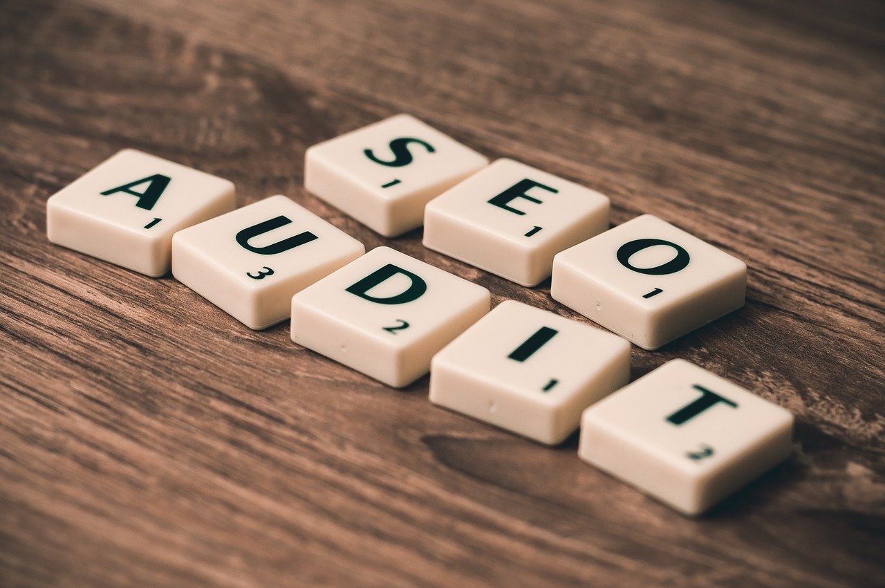 Scrabble words spelling out SEO audit, one of the best uses of free keyword research tools