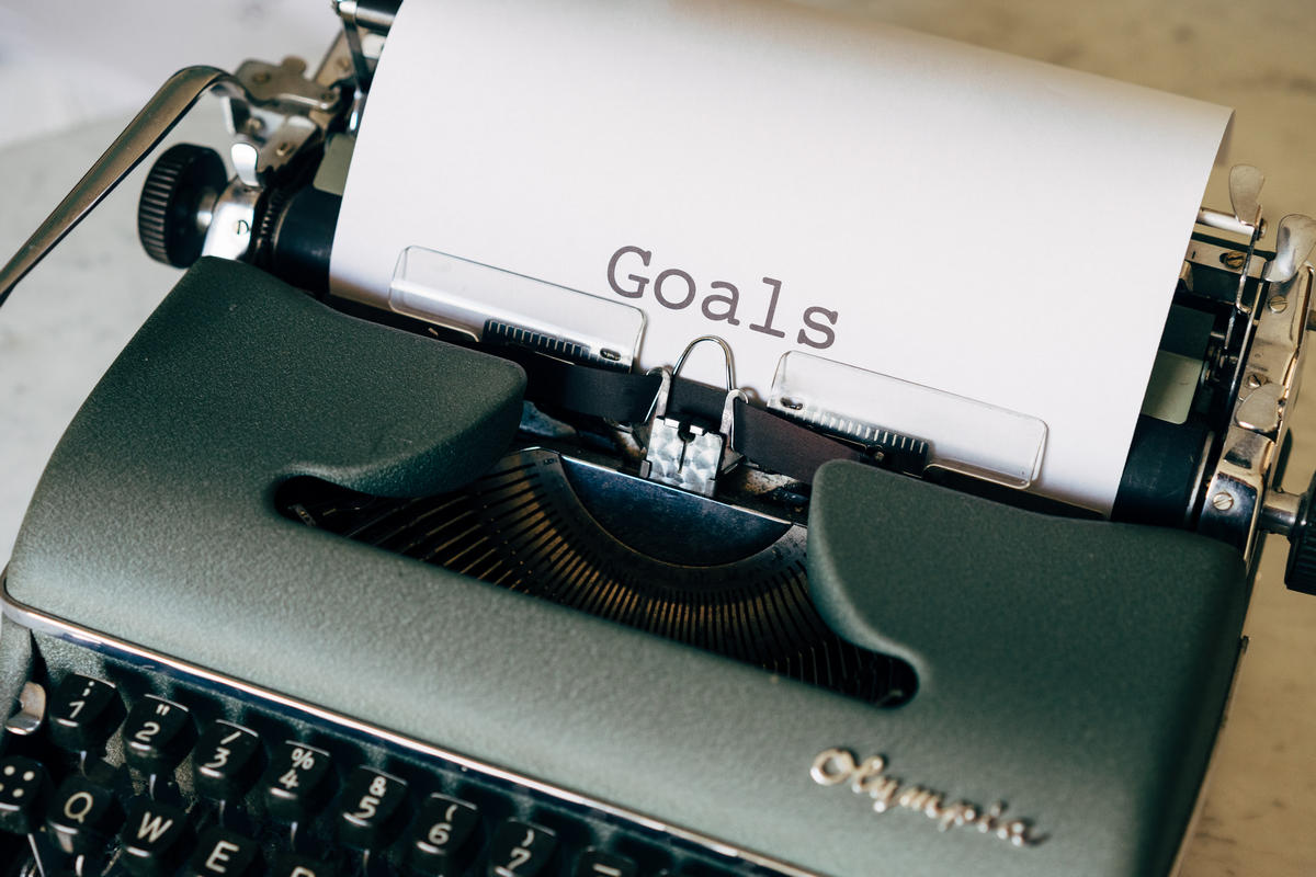 A typewriter with a piece of paper saying 'Goals', something that needs defining when writing LinkedIn articles
