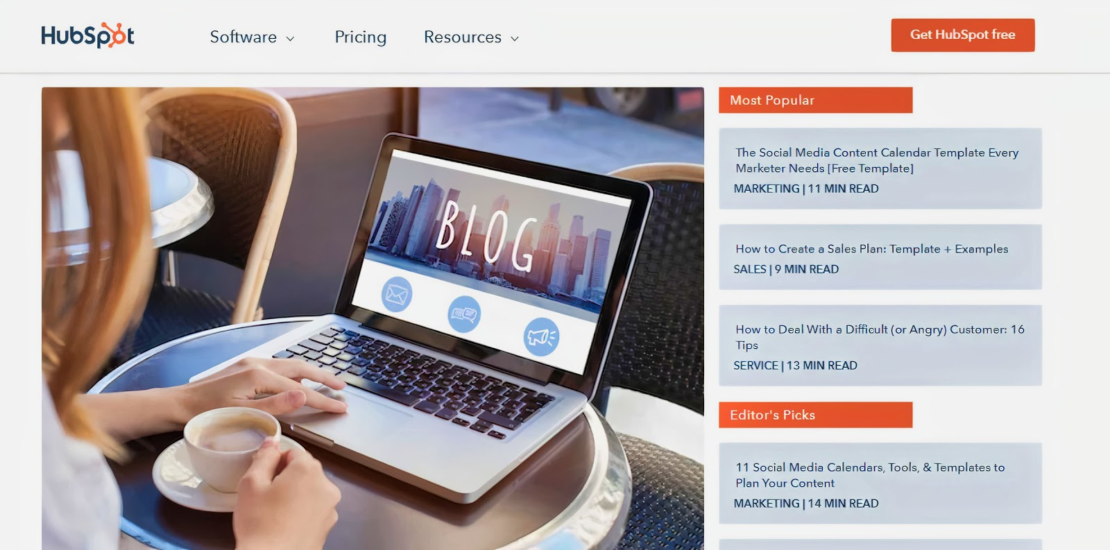 A screenshot of a HubSpot webpage, showing someone looking at their laptop which shows the word 'BLOG'
