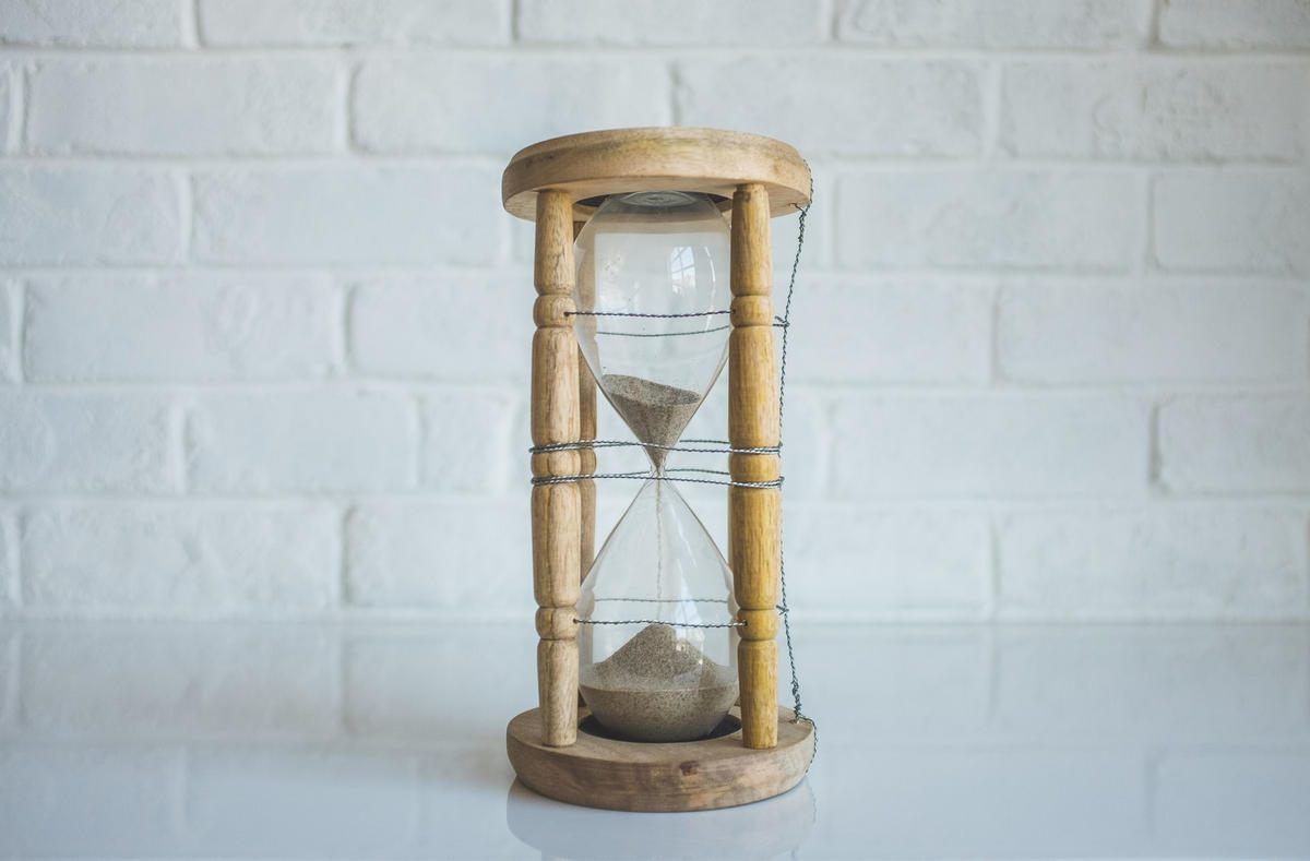 A wooden egg timer already halfway through the sand, indicating that guest blogging can take up a lot of time
