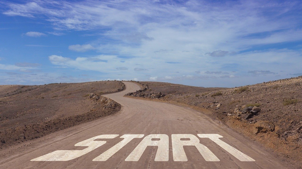 "A long road with the word ""start"". At the start of your writing career you may want to write a free test article."