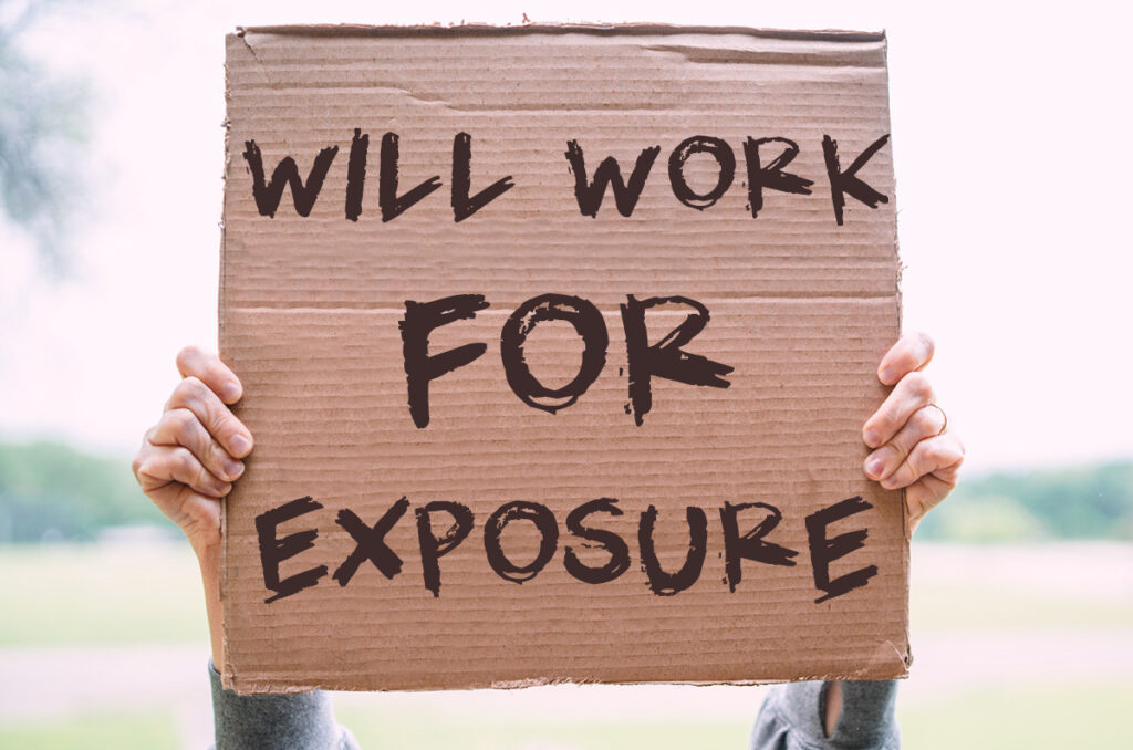 Person holding up a will work for exposure sign